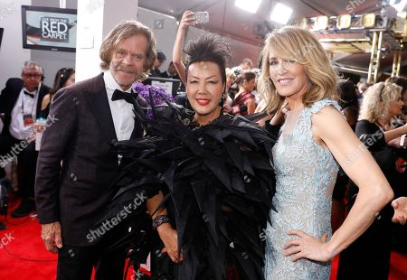 William H. Macy, Sue Wong, Felicity Huffman. William H. Macy, from left, Sue Wong, and Felicity Huffman arrive at the 69th Primetime Emmy Awards, at the Microsoft Theater in Los Angeles