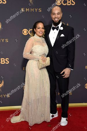 Amber Christine, Peter Saji. Amber Christine, left, and Peter Saji arrive at the 69th Primetime Emmy Awards, at the Microsoft Theater in Los Angeles
