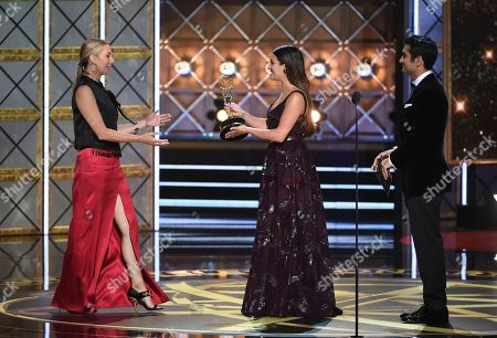 """Audrey Morissey, Lea Michele, Kumail Nanjiani. Audrey Morrissey, left, accepts the award for for outstanding reality-competition program for """"The Voice"""" from Lea Michele, center, and Kumail Nanjiani at the 69th Primetime Emmy Awards, at the Microsoft Theater in Los Angeles"""