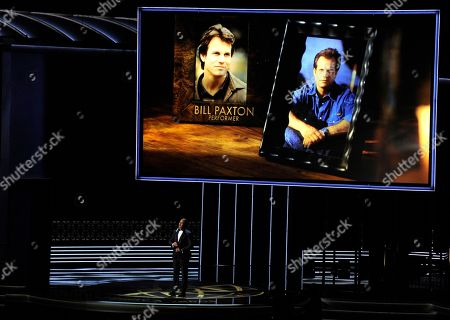 Christopher Jackson, Bill Paxton. Christopher Jackson sings as a picture of Bill Paxton appears onscreen during an in memoriam tribute at the 69th Primetime Emmy Awards, at the Microsoft Theater in Los Angeles