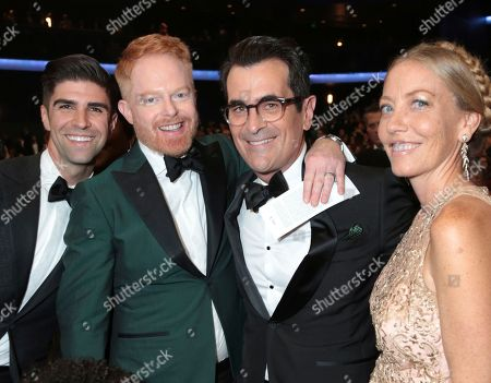 Stock Picture of Justin Mikita, Jesse Tyler Ferguson, Ty Burrell, Holly Burrell. Justin Mikita, from left, Jesse Tyler Ferguson, Ty Burrell and Holly Burrell pose in the audience at the 69th Primetime Emmy Awards, at the Microsoft Theater in Los Angeles