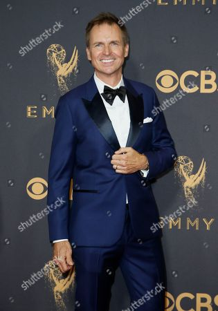 Phil Keoghan arrives at the 69th Primetime Emmy Awards, at the Microsoft Theater in Los Angeles