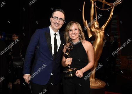 "John Oliver, Liz Stanton. Liz Stanton, right, and John Oliver of ""Last Week Tonight with John Oliver"", winner the award for outstanding variety talk series, pose backstage at the 69th Primetime Emmy Awards, at the Microsoft Theater in Los Angeles"