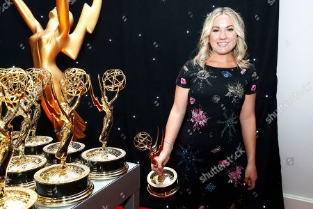 "Erin Doyle poses at the trophy table with her award for Outstanding Variety/Sketch Series for ""Saturday Night Live"" attends the 69th Primetime Emmy Awards, at the Microsoft Theater in Los Angeles"