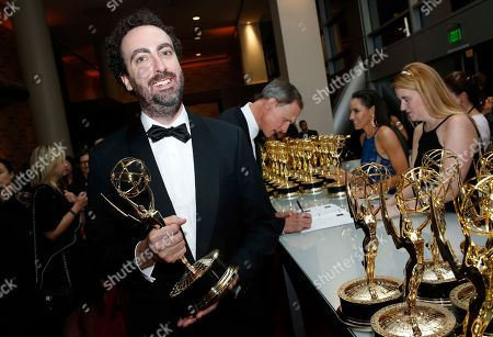 Stock Picture of Gary Shteyngart holds his award at the trophy table during the 69th Primetime Emmy Awards, at the Microsoft Theater in Los Angeles