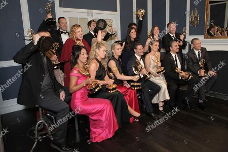 Audrey Morrissey, center, and The Voice' members, winners of Outstanding Reality Competition Program pose at the 69th Primetime Emmy Awards, at the Microsoft Theater in Los Angeles