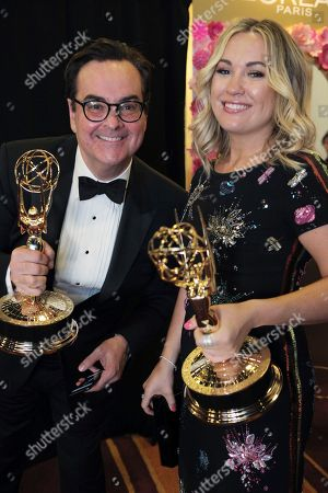 "Steve Higgins, Erin Doyle. Steve Higgins, left, and Erin Doyle pose with their awards for Outstanding Variety/Sketch Series for ""Saturday Night Live"" at the 69th Primetime Emmy Awards, at the Microsoft Theater in Los Angeles"
