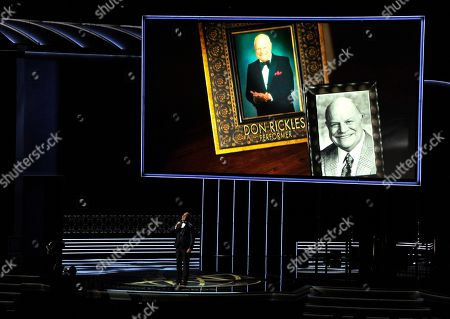 Stock Picture of Christopher Jackson, Don Rickles. Christopher Jackson sings as a picture of Don Rickles appears onscreen during an in memoriam tribute at the 69th Primetime Emmy Awards, at the Microsoft Theater in Los Angeles