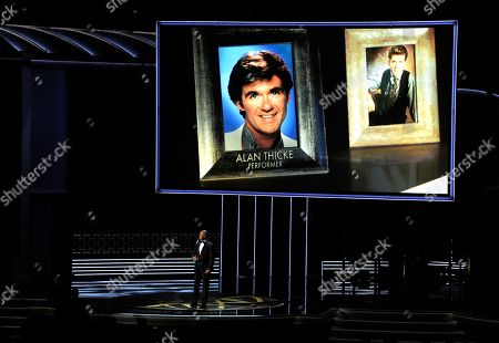 Stock Image of Christopher Jackson, Alan Thicke. Christopher Jackson sings as a picture of Alan Thicke appears onscreen during an in memoriam tribute at the 69th Primetime Emmy Awards, at the Microsoft Theater in Los Angeles