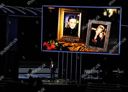 Christopher Jackson, Carrie Fisher. Christopher Jackson sings as a picture of Carrie Fisher appears onscreen during an in memoriam tribute at the 69th Primetime Emmy Awards, at the Microsoft Theater in Los Angeles
