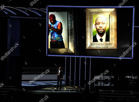 Stock Picture of Christopher Jackson, Nelsan Ellis. Christopher Jackson sings as a picture of Nelsan Ellis appears onscreen during an in memoriam tribute at the 69th Primetime Emmy Awards, at the Microsoft Theater in Los Angeles