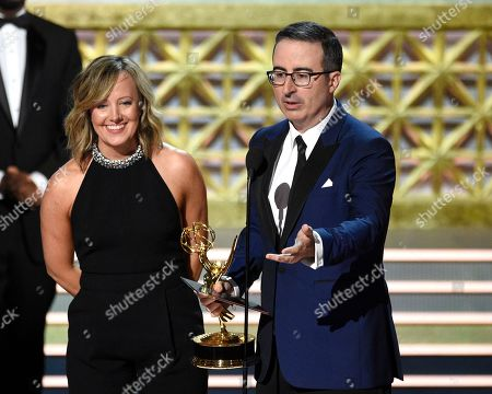 "Liz Stanton, John Oliver. Liz Stanton, left, and John Oliver of ""Last Week Tonight with John Oliver"" accept the award for outstanding variety talk series at the 69th Primetime Emmy Awards, at the Microsoft Theater in Los Angeles"