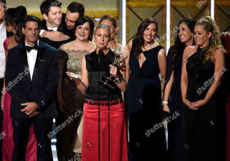 """Audrey Morrissey accepts the award for outstanding reality-competition program for """"The Voice"""" at the 69th Primetime Emmy Awards, at the Microsoft Theater in Los Angeles"""