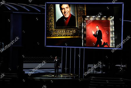 Christopher Jackson, Jerry Lewis. Christopher Jackson sings as a picture of Jerry Lewis appears onscreen during an in memoriam tribute at the 69th Primetime Emmy Awards, at the Microsoft Theater in Los Angeles