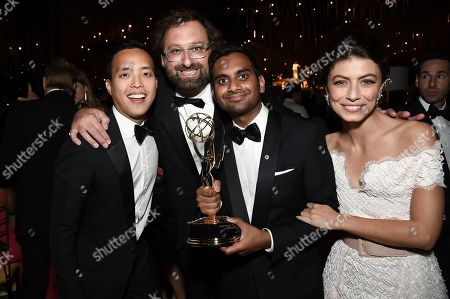 Stock Image of Kelvin Yu, Eric Wareheim, Aziz Ansari, Alessandra Mastronardi. Kelvin Yu, from left, Eric Wareheim, Aziz Ansari, and Alessandra Mastronardi attend the Governors Ball after the 2017 Primetime Emmys Awards at the Microsoft Theater, in Los Angeles