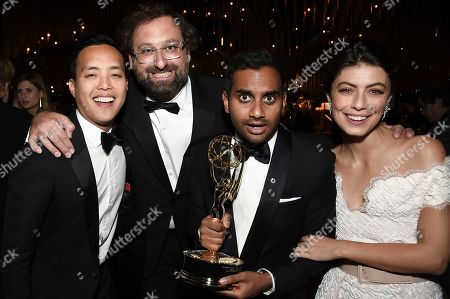 Stock Picture of Kelvin Yu, Eric Wareheim, Aziz Ansari, Alessandra Mastronardi. Kelvin Yu, from left, Eric Wareheim, Aziz Ansari, and Alessandra Mastronardi attend the Governors Ball during the 2017 Primetime Emmys Awards at the Microsoft Theater, in Los Angeles