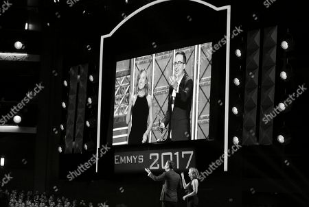 "Liz Stanton, John Oliver. Liz Stanton, right, and John Oliver of ""Last Week Tonight with John Oliver"" accept the award for outstanding variety talk series at the 69th Primetime Emmy Awards, at the Microsoft Theater in Los Angeles"