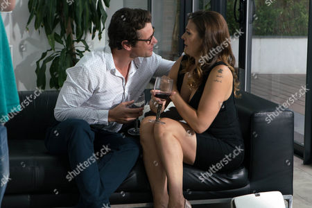 Ep 9254 Wednesday 20th September 2017 - 2nd Ep Pouring Michelle Connor, as played by Kym Marsh, a glass of wine, Will, as played by Leon Ockenden, suggests she should move in with him so that he can protect her from her stalker. Michelle promises to think about it but when Will leans in for a kiss how will she react? Alone in Will's living room, Michelle's shocked to stumble across a folder full of photos of herself and realises with horror that he's her stalker. Michelle suddenly realises she's in grave danger.