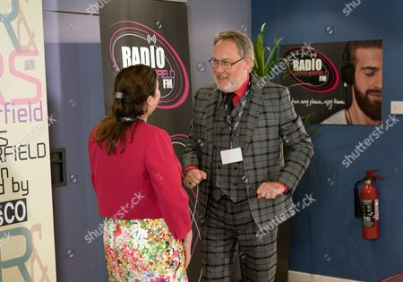 Ep 9251 Monday 18th September 2017 - 1st Ep  Norris Cole, as played by Malcolm Hebden, and Mary Cole, as played by Patti Clare, arrive at the radio station for the Mr & Mrs competition. Colin, as played by Vic Reeves, from Marketing heads over and having discovered that Norris runs a newsagents, makes a huge fuss of them, insisting they've got so much in common.