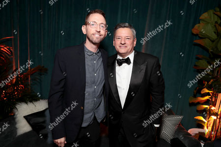 Neal Brennan and Ted Sarandos, Netflix Chief Content Officer, seen at Netflix Primetime Emmys Party at NeueHouse in Los Angeles, CA on September 17, 2017