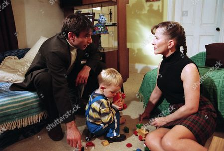 Stock Image of Graham Rysinski, as played by Paul Opacic; Gina Ward, as played by Tricia Penrose