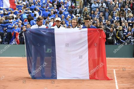 The french team (Nicolas Mahut, Pierre Hugues Herbert, Lucas Pouille and Jo Wilfried Tsonga) celebrate after the match