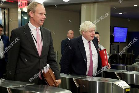 Boris Johnson, Matthew Rycroft. Britain's Foreign Minister Boris Johnson, right, accompanied by his United Nations Ambassador Matthew Rycroft, arrives at the U.N