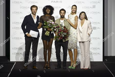 Director of the Mercedes-Benz Fashion Week Madrid, Charo Izquierdo (R), and model and hostess Laura Sanchez (2-R) pose with L'Oreal Awards best designer Juan Vidal (C) and best model Aya Gueye (2-L) during the Mercedes-Benz Fashion Week Madrid, in Madrid, Spain, 18 September 2017. The MBFW Madrid runs from 14 to 19 September.