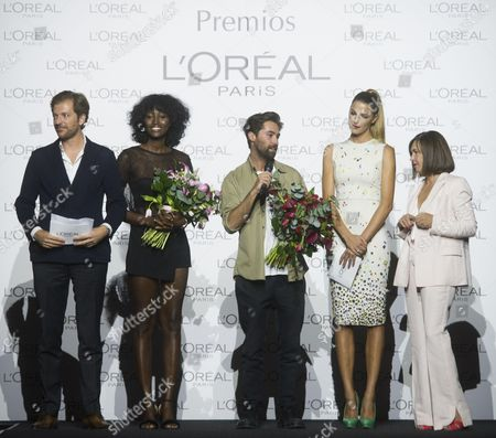 L'oreal Best model Aya Gueye (2L), L'oreal best designer Juan Vidal (C), Laura Sanche (2R)z and Charo Izquierdo, director of MBFW (R)