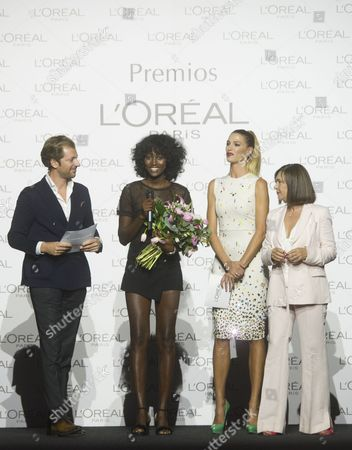 L'oreal Best model Aya Gueye (2L), Laura Sanche (2R)z and Charo Izquierdo, director of MBFW (R)
