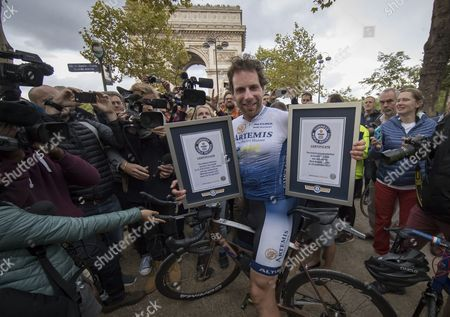 British athlete and adventurer Mark Beaumont celebrates with his two new world records as he arrives in Paris after cycling 29,000 kilometers (18,000 miles) around the world in a record-setting 79 days, in Paris, France, 18 September 2017. Beaumont set off from Paris on 02 July, and averaged 390 kilometer (240 miles) per day, cycling 16 hours a day as he cycled across Europe, Asia, Australia, New Zealand, and North America before reaching Paris in 79 days. His endeavour earned him the Guinness world record for fastest world circumnavigation by bicycle, and farthest distance cycled in one month.