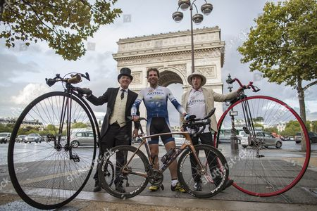 British athlete and adventurer Mark Beaumont poses with men with old bicycles as he arrives in Paris after cycling 29,000 kilometers (18,000 miles) around the world in a record-setting 79 days, in Paris, France, 18 September 2017. Beaumont set off from Paris on 02 July, and averaged 390 kilometer (240 miles) per day, cycling 16 hours a day as he cycled across Europe, Asia, Australia, New Zealand, and North America before reaching Paris in 79 days. His endeavour earned him the Guinness world record for fastest world circumnavigation by bicycle, and farthest distance cycled in one month.