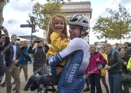 British athlete and adventurer Mark Beaumont holds his daughter as he arrives in Paris after cycling 29,000 kilometers (18,000 miles) around the world in a record-setting 79 days, in Paris, France, 18 September 2017.  Beaumont set off from Paris on 02 July, and averaged 390 kilometer (240 miles) per day, cycling 16 hours a day as he cycled across Europe, Asia, Australia, New Zealand, and North America before reaching Paris in 79 days. His endeavour earned him the Guinness world record for fastest  world circumnavigation by bicycle, and farthest distance cycled in one month.