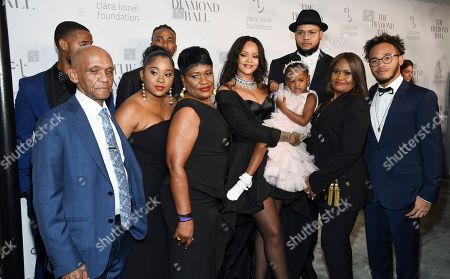 Rihanna, Rorrey Fenty, Rajad Fenty, Lionel Braithwaite, Monica Braithwaite, Kandy Fenty. Singer Rihanna poses with her family at the 3rd Annual Diamond Ball at Cipriani Wall Street, in New York