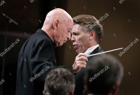 US lyric baritone Thomas Hampson (R), accompanied by  Orchestre National de France under the baton of  German born conductor Christoph Eschenbach (L) performs Gustav Mahler's 'Ruckert-Lieder' (Songs after Rückert) at Grand Palace Concert Hall during the George Enescu International Festival in Bucharest, Romania, late 18 September 2017. The festival, held since 1958 every two years, is the biggest classical music festival held in Romania, in honor of famous Romanian composer and violinist George Enescu.