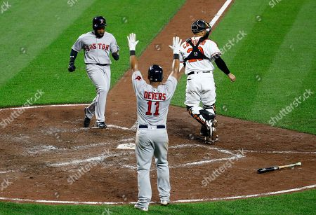 Jackie Bradley Jr, Rafael Devers, Welington Castillo. Boston Red Sox's Jackie Bradley Jr., top left, and Rafael Devers score in front of Baltimore Orioles catcher Welington Castillo, right, on Brock Holt's single in the fifth inning of a baseball game in Baltimore