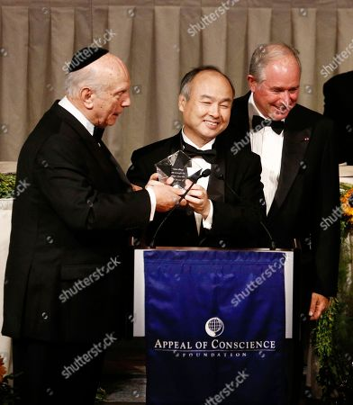 Arthur Schneier, Masayoshi Son, Stephen A. Schwarzman pose. President and founder of The Appeal of Conscience Foundation Rabbi Arthur Schneier, left to right, Chairman and CEO of SoftBank Group Masayoshi Son, award recipient, and Chairmen of the Awards Dinner and Chairman and CEO of Blackstone Stephen A. Schwarzman pose on stage during the Appeal of Conscience Foundation Gala at New York Hilton on in New York. The Appeal of Conscience Foundation, an interfaith organization, which has brought together corporate and religious leaders for more than half a century who are dedicated to religious freedom, human rights and tolerance, honors corporate global leaders from the United States, Europe and Asia with 2017 Appeal of Conscience Awards