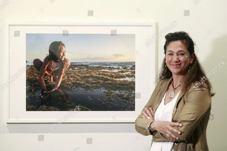 Stock Picture of Mexican photographer Cristina Mittermeier poses next to one of her works during the presentation of her exhibition 'Na Beira' as part of the Festival Mar de Mares in A Coruna, province of Galicia, northwestern Spain, on 19 September 2017.