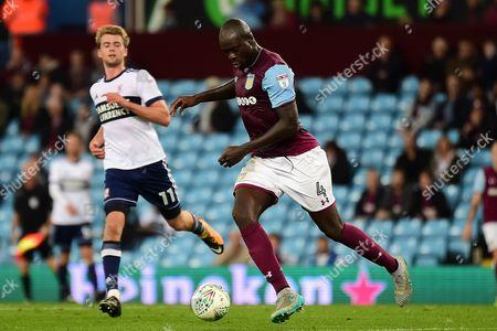 Aston Villa defender Christopher Samba (4) sprints forward with the ball during the EFL Cup match between Aston Villa and Middlesbrough at Villa Park, Birmingham