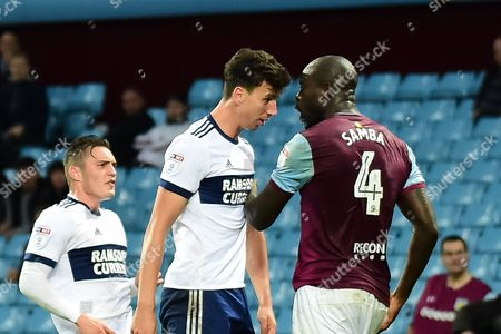 Middlesbrough defender Daniel Ayala (4) toe to toe with Aston Villa defender Christopher Samba (4) during the EFL Cup match between Aston Villa and Middlesbrough at Villa Park, Birmingham