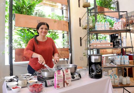 Stock Image of Celebrity Chef and Food Network personality Alex Guarnaschelli leads an interactive cooking demonstration of her exclusive Folgers® Simply Gourmet? recipes at Bouley Botanical, in New York