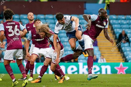 Middlesbrough defender Daniel Ayala (4) challenges Aston Villa defender Christopher Samba (4)  during the EFL Cup match between Aston Villa and Middlesbrough at Villa Park, Birmingham