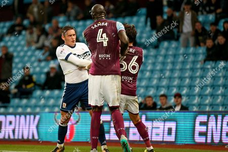 Middlesbrough defender Connor Roberts (23), on loan from Swansea City, has a rumble with Aston Villa defender Christopher Samba (4)  during the EFL Cup match between Aston Villa and Middlesbrough at Villa Park, Birmingham