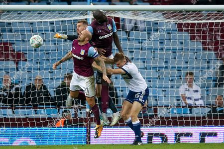 Middlesbrough forward George Miller (45) is in the mix as big Aston Villa defender Christopher Samba (4) clears the danger during the EFL Cup match between Aston Villa and Middlesbrough at Villa Park, Birmingham