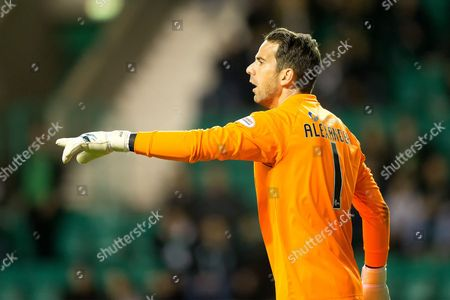 Livingston goalkeeper Neil Alexander (#1) issues instructions at a corner during the Betfred Scottish Cup match between Hibernian and Livingston at Easter Road, Edinburgh