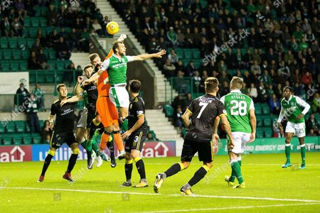 Livingston goalkeeper Neil Alexander (#1) punches the ball clear from a corner during the Betfred Scottish Cup match between Hibernian and Livingston at Easter Road, Edinburgh