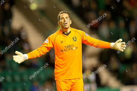 Livingston goalkeeper Neil Alexander (#1) protests the foul that leads to a Hibernian penalty during the Betfred Scottish Cup match between Hibernian and Livingston at Easter Road, Edinburgh