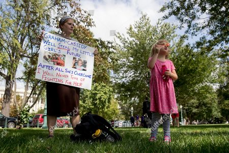 Rebecca Wood, Charlie Wood. Rebecca Wood of Charlottesville, Va., watches as he daughter, Charlie, 5, blows bubbles at a rally of health care advocates, grassroots activists, and concerned constituents outside the Capitol in Washington, . Charlie had medical complications and was born prematurely at 26 weeks. Senate Republicans begin another push to repeal the Affordable Care Act with the Graham-Cassidy proposal