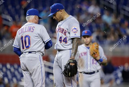 AJ Ramos, Terry Collins. New York Mets relief pitcher AJ Ramos (44) is relieved from the game by manager Terry Collins (10) during the ninth inning of a baseball game against the Miami Marlins, in Miami. The Marlins won 5-4 in ten innings