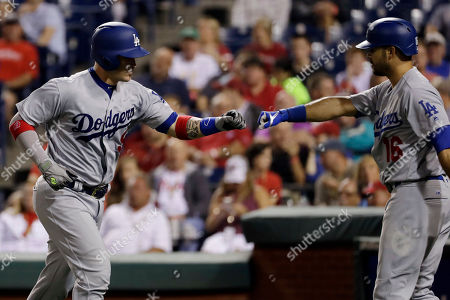 Yasmani Grandal, Andre Ethier. Los Angeles Dodgers' Yasmani Grandal, left, and Andre Ethier celebrate after Grandal's home run off Philadelphia Phillies starting pitcher Aaron Nola during the third inning of a baseball game, in Philadelphia